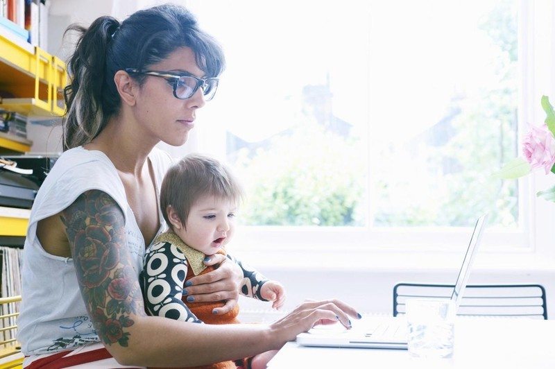 Open_learning_woman_with_baby.jpg