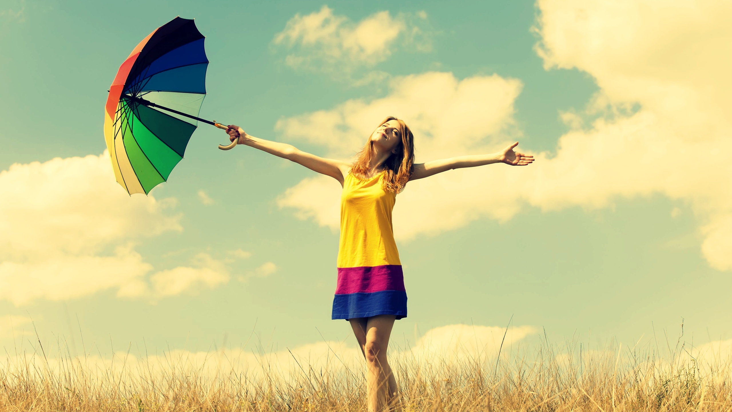 Happiness-girl-rainbow-umbrella-warmth-nature-sky-clouds_2560x1440.jpg