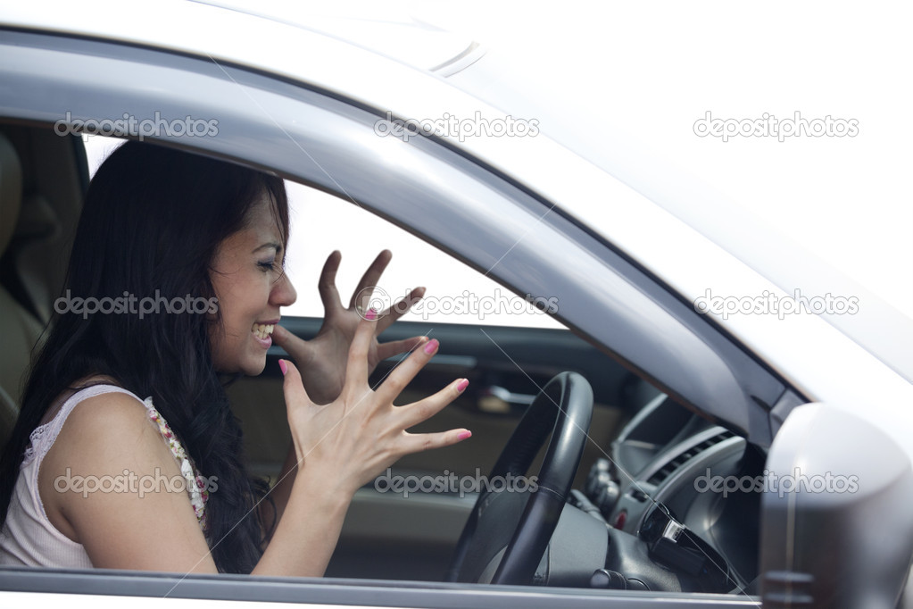 depositphotos_10986578-Angry-female-driver-driving-a-car.jpg
