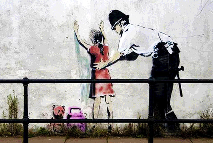 Banksy-Bristol-Graffiti-Frisk-Police-Little-Girl.jpg