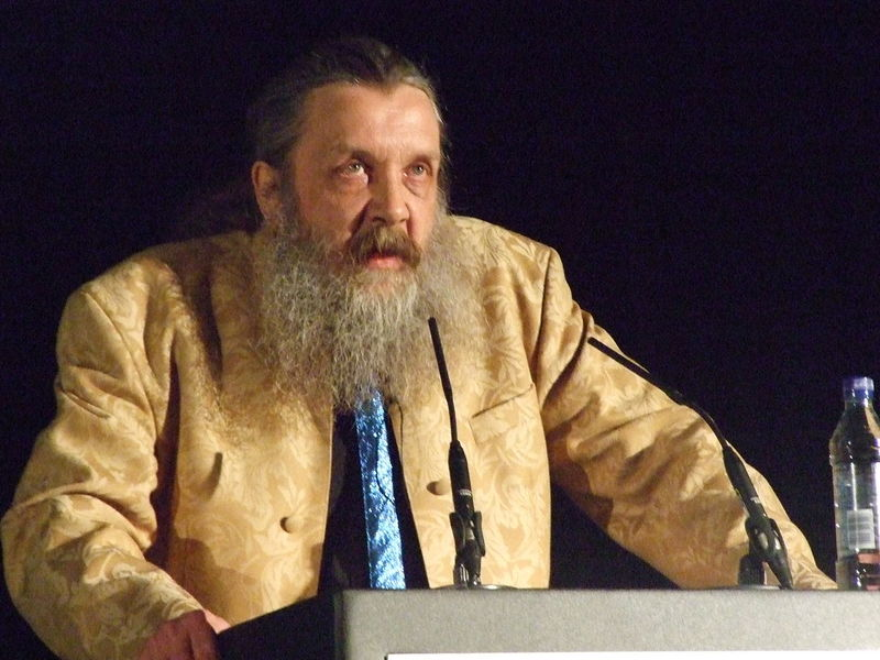 1280px-Alan_Moore_speaking_at_TAM_London_2010.jpg