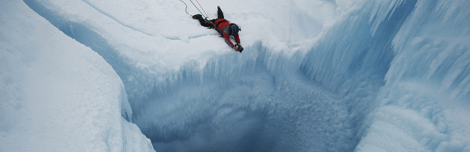 slider2-man-looking-into-glacier.jpg