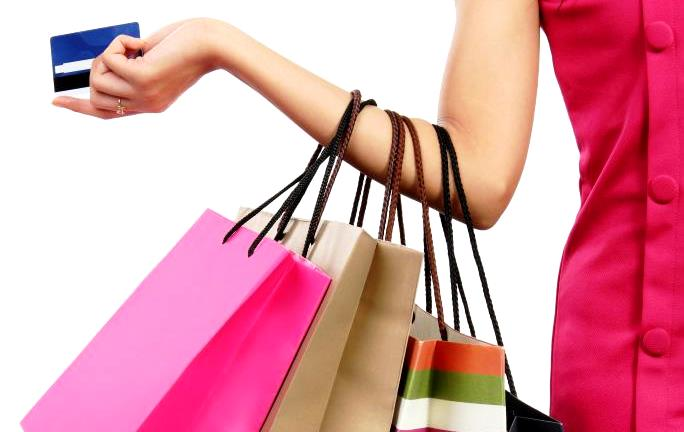 woman-with-credit-card-and-shopping-bags.jpg