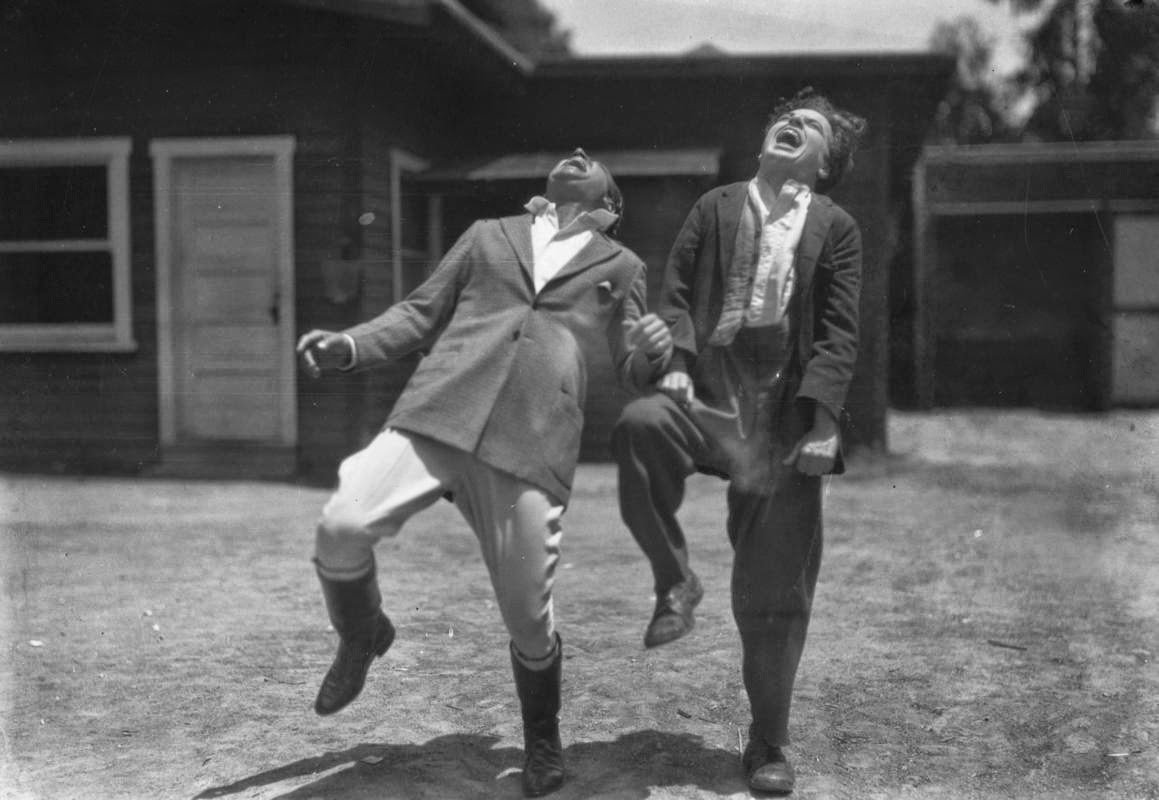 Charlie Chaplin and Douglas Fairbanks enjoying themselves, 1920s.jpg