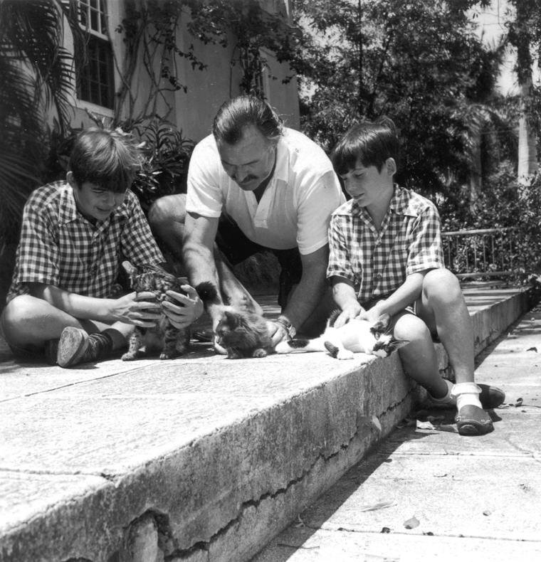 Ernest_Hemingway_with_sons_Patrick_and_Gregory_with_kittens_in_Finca_Vigia,_Cuba.jpg